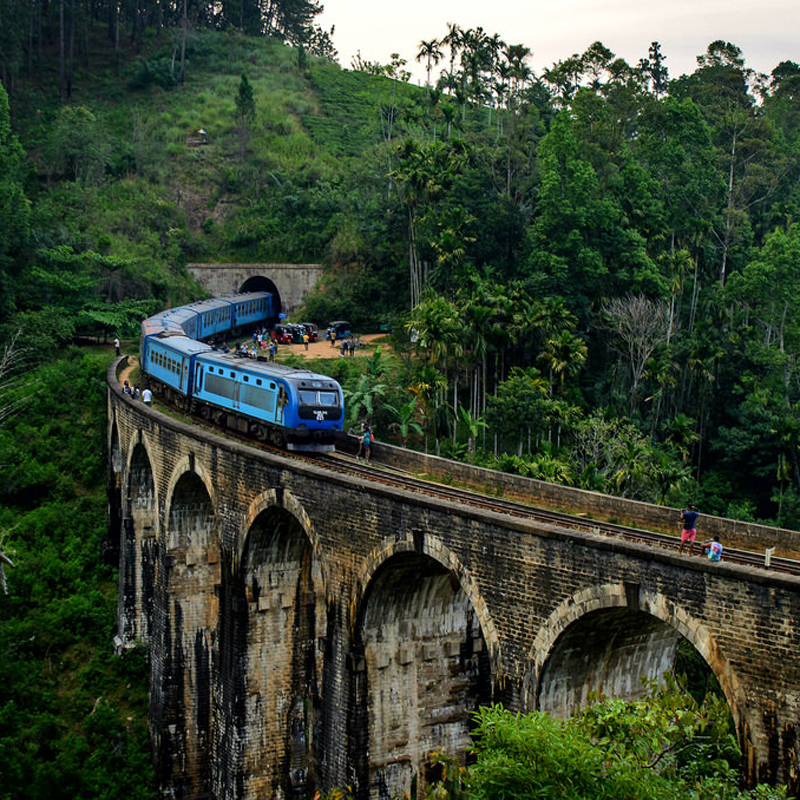 Podi Manike Passing the Nine Arch Bridge