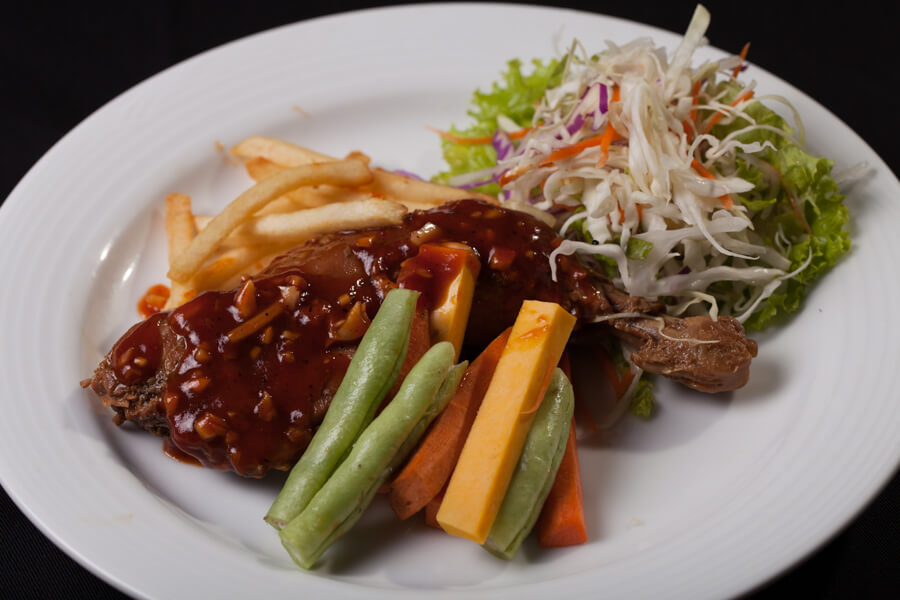 Roasted Chicken with a Side of Salad at Senani Hotel